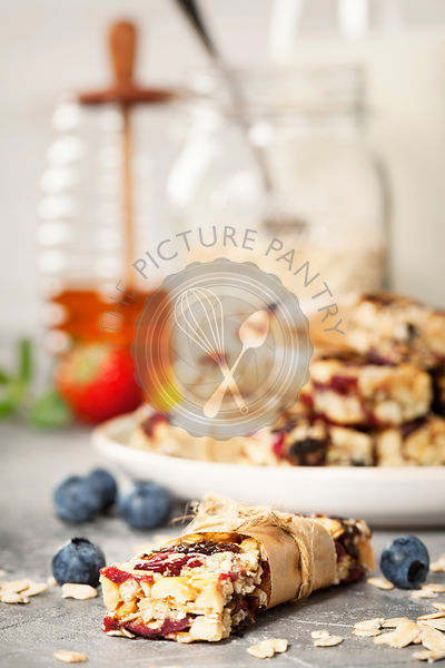 Granola bar on a grey rustic table. Healthy energy snack