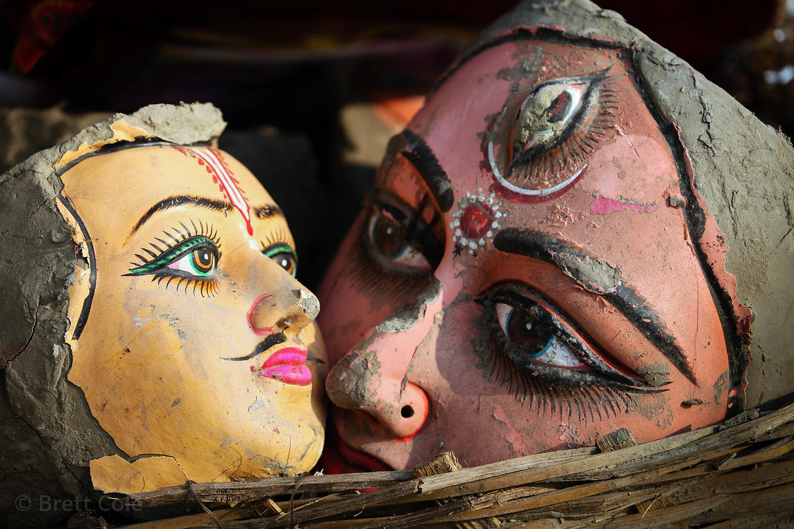 Ceramic heads from a religious idol that was immersed in the Hooghly River during the Durga Puja festival. The heads were sca...