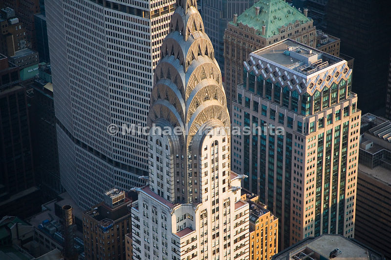 One of the most beloved skyscrapers in New York City, the Chrysler Building, stands near one of the most criticized, the MetLife Building.