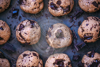 Baked chocolate chip cookies on a baking tray