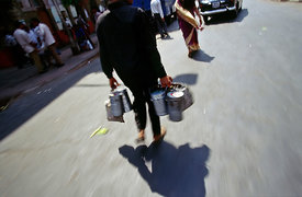 Dhaba Wallah rushing lunch boxes (tiffin boxes) through the streets of, Bombay, India