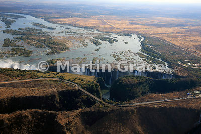 Victoria Falls (Mosi-oa-Tunya) from the air, mostly Zambia but land and road to left (west) of Victoria Falls Bridge is Zimbabwe