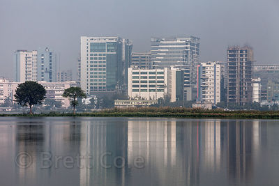 The planned satellite city of Salt Lake City, reflected in the waters of the East Kolkata Wetlands, Kolkata, India.