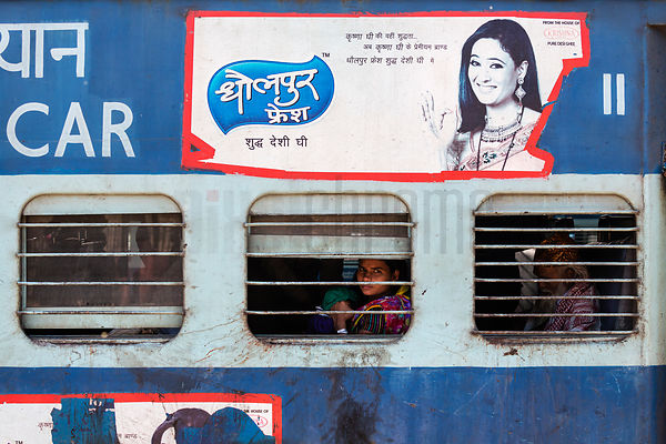 People Sitting on Indian Railways Train
