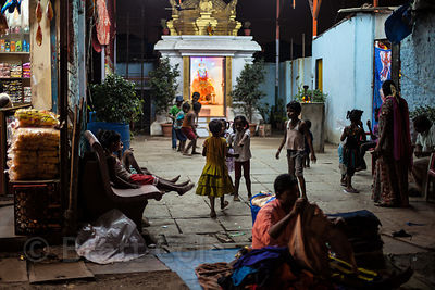 Children play in a temple yard at night, near the Kokri Agar slum area, Mumbai, India.