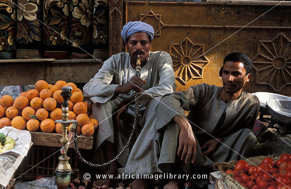 man smoking a water pipe or Sheesha at the market, Luxor, Egypt