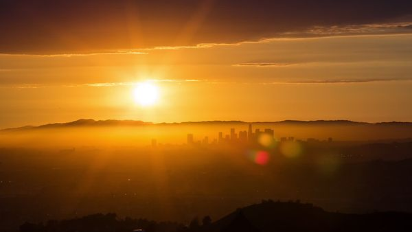 Bird's Eye: Subtle Movement Of Golden Sun Rays Over Los Angeles