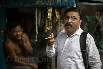 A man smokes a cigarette, BBD Bagh, Kolkata, India. Tobacco use among men is epidemic in India, both cigarettes and chewing t...
