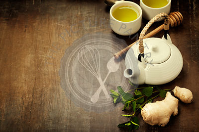Tea with mint, ginger and lemon on wooden background