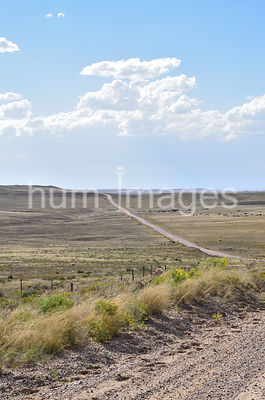 A gravel road can be seen for miles in the Pawnee National Grasslands