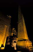 Obelisk (25m high) and colossal statue of Rameses II in the Temple of Luxor, Luxor, Egypt