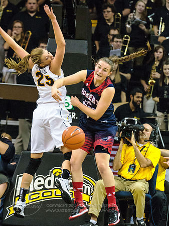 Robert Morris' Megan Smith (22) and Iowa's Kali Peschel (25) avie for a loose ball during the first half of play at Carver-Ha...