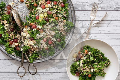 Kale salad with a serving on a plate.