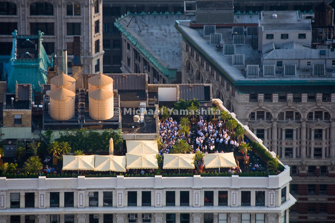 Rooftops in New York hold not only heating and cooling systems, but also summertime revels.  Manhattan, New York City.