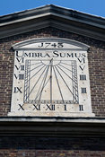 "UK - London - The iron sundial on the wall of the Mosque off Brick Lane dating from 1743 with the motto ""Umbra Sumus"" - meani..."