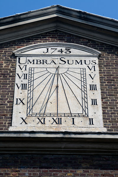 "UK - London - The iron sundial on the wall of the Mosque off Brick Lane dating from 1743 with the motto ""Umbra Sumus"" - meaning 'we are but shadows. Spitalfields."