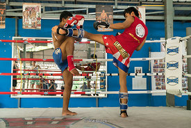Two kickboxers practicing in the arena at Thaling Ngam Mauythai boxing gym, Thailand.