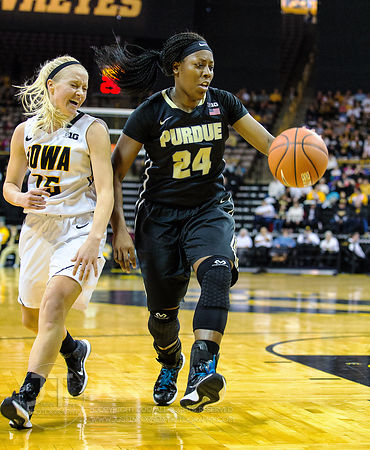 Iowa's Whitney Jennings (15) reacts to Purdue's Andreona Keys (24) during the first half of play at Carver-Hawkeye Arena in I...
