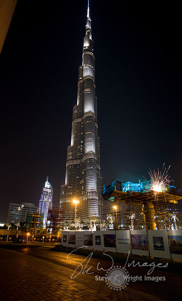 Building the Future - Construction work and the Burj Khalifa at night - Dubai, United Arab Emirates