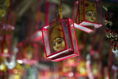 Small glass boxes with idols for sale at a market in Kalighat, Kolkata, India.