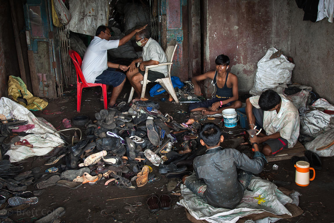 The much lauded recycling program in the Dharavi slum in Mumbai, India is not all positives. Here children work in a dark, di...