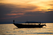 Tourist boat on Lake Tanganyika at sunset, Mahale Mountains National Park, Tanzania