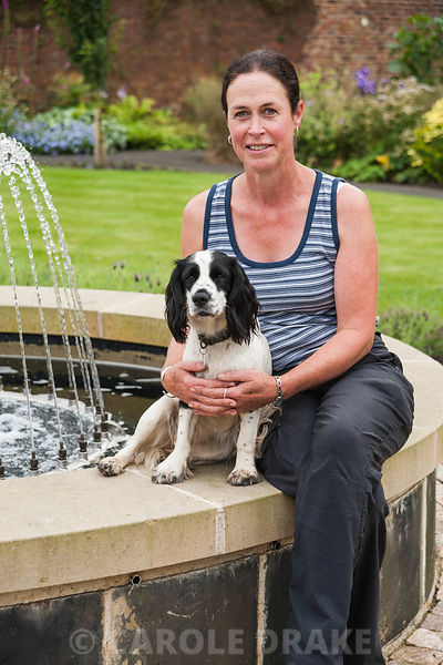 Jane Johnson, head gardener and planting designer with her dog Lexie. Acton House, Felton, Morpeth, Northumberland, UK