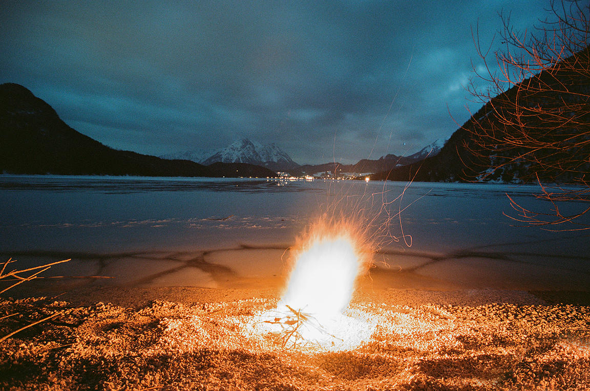 Fire by the frozen lake