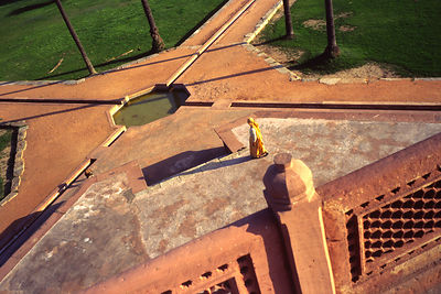 India - Delhi - A gardener (mali) walks across the grounds of Humayun's tomb