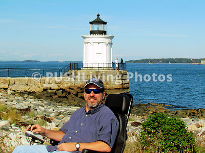 Man in a power chair on enjoying coastal scenery