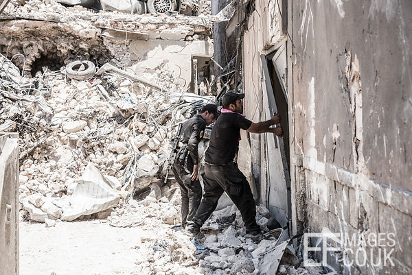 Iraqi Special Forces break open a door into the Church of St Thomas, used until its liberation as a base  by ISIS Fighters. O...