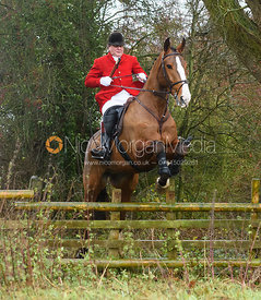David Bellamy jumping a hunt jump in Holwell. The Belvoir Hunt at Hill Top Farm 1/12
