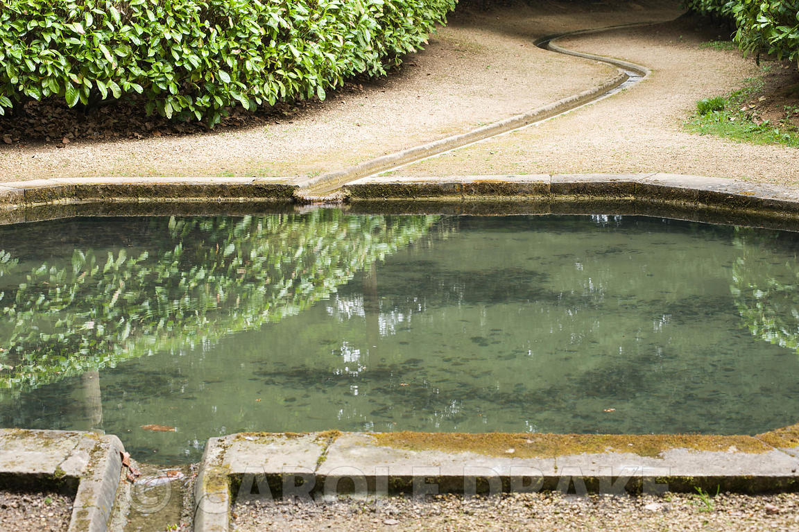 Rill leading along the Watery Walk to and from the Plunge Pool, between laurel hedges. Rousham House, Bicester, Oxon, UK
