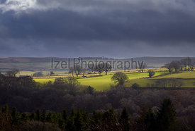 Sun breaking through the cloud over English Farmland, Muggleswick Common near Edmundbyers, England, UK.