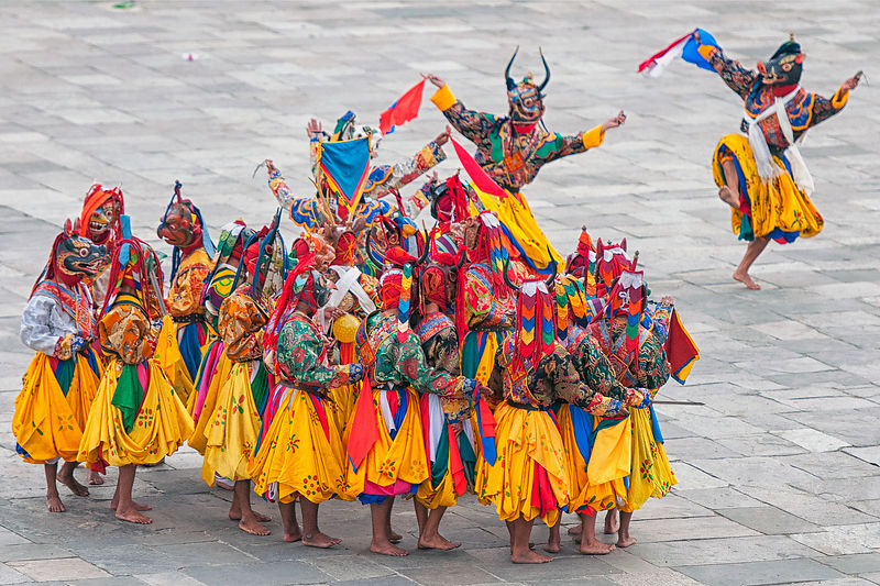 Folk dancers perform during the Thimphu festival. This photograph was shot in a monastery in Bhutan.