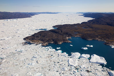 Aerial view of the Ilulissat Icefjord, with the Sermeq Kujalleq Glacier or Jakobshavn Isbrae entering the sea, near  Ilulissa...