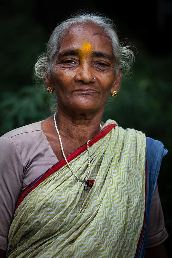 An elderly woman on her way to visit Babulnath temple, Mumbia, India.