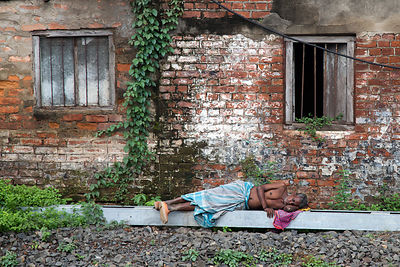 Man taking an afternoon nap during monsoon, Ballygunge, Kolkata, India