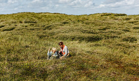Danish woman and girl together in the dunes in Thy