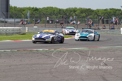 Aston Martins racing for position, at the Silverstone 500 - in the third round of the British GT Championship 2014 - 1st June...