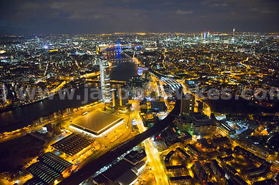Aerial view over Battersea Nine Elms development at night, London