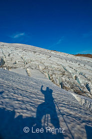 The photographer waving and looking across Easton Glacier, Mt. Baker–Snoqualmie National Forest, Washington, USA, September, ...