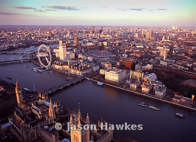 Aerial view of the London Eye and Houses of Parliament at sunset, London