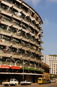 Mozambique, Beira, Derelict highrise appartment buildings dot the city. Typical curved building with art-deco influence.