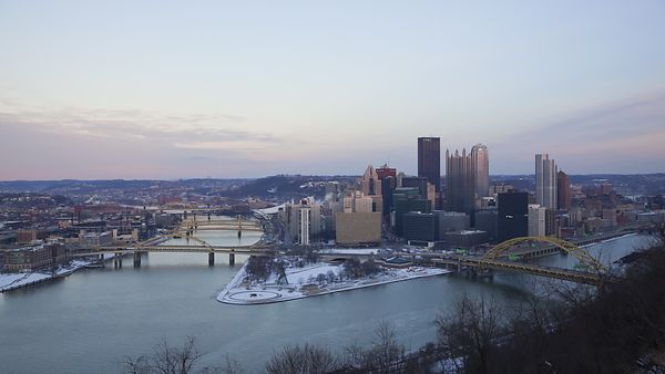 Wide Shot: Downtown Pittsburg Sunset Lights Up Point State Park