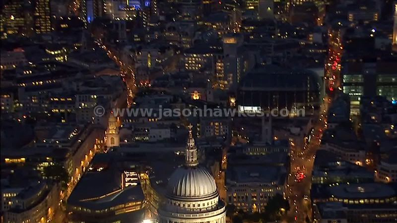 Aerial view over the City of London and St Paul's Cathedral at night, London, England, UK