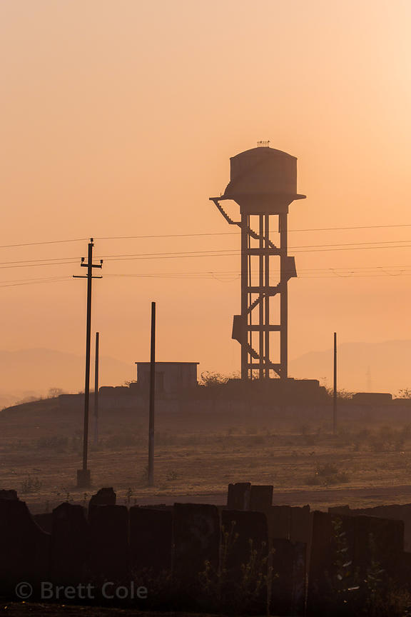 Silhouette of a concrete water tower, Daurai Rural, Ajmer, Rajasthan, India. Such towers are a very common site throughout ru...