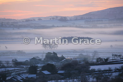 Cold, misty Lyth Valley sunrise with snow, December 28, Cumbria, England