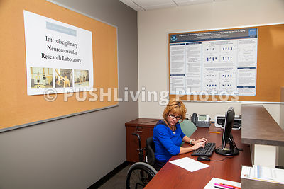 Female receptionist using a wheelchair