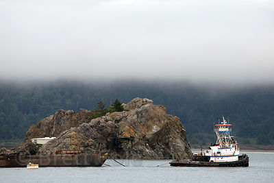 A tug boat and rocks in the Pacific Ocean, Crescent City, California